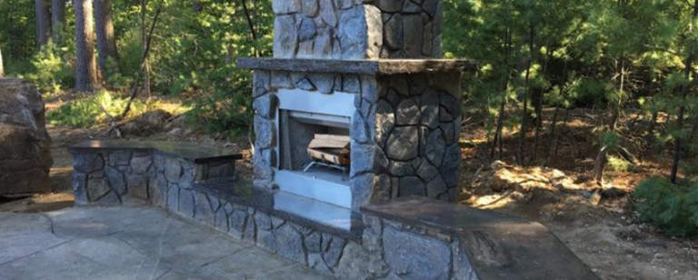Outdoor Fireplace Feature by H&M Landscaping.