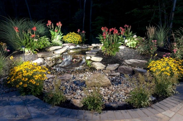 Landscape Enhancements like this Waterfall will Take Your Property to the Next Level