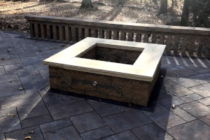 An Outdoor Firepit Installed by H&M Landscaping in Cleveland, Ohio