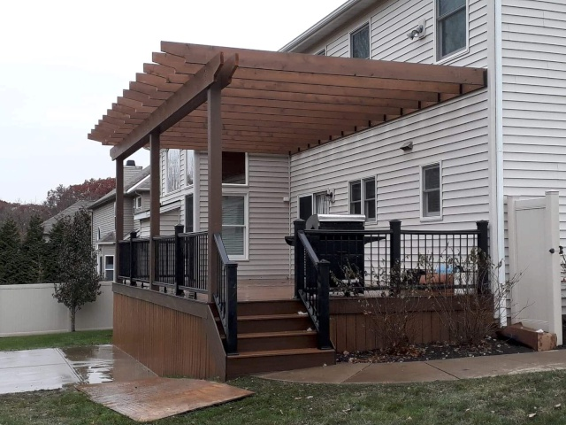 Cedar Pergola Covering Deck Built by H&M Landscaping