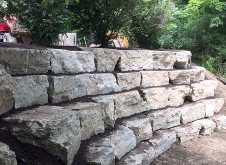 Natural Stone Retaining Wall Landscape Installation in Kirtland Ohio