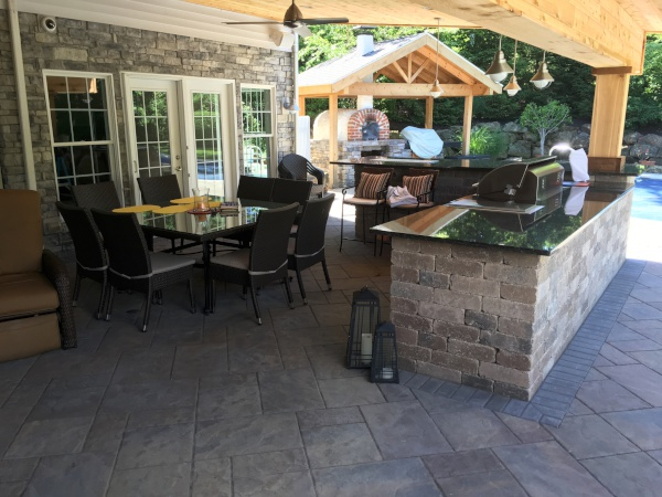 Heat-proof Outdoor Living Space with Overhead Cedar Covered Kitchen in Richfield Ohio