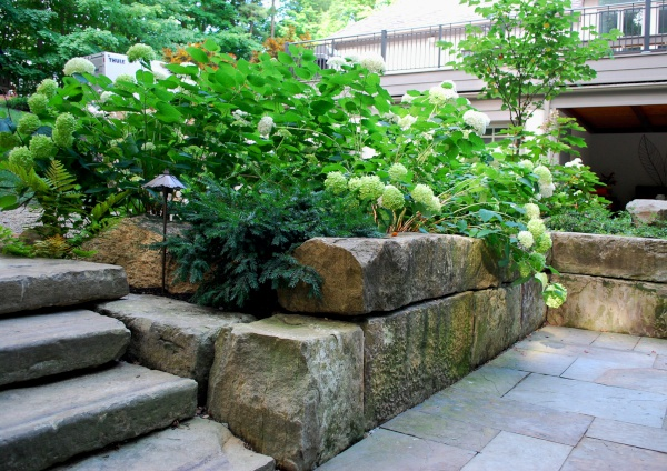 Natural Stone Landscapes & Retaining Walls by H&M Landscaping