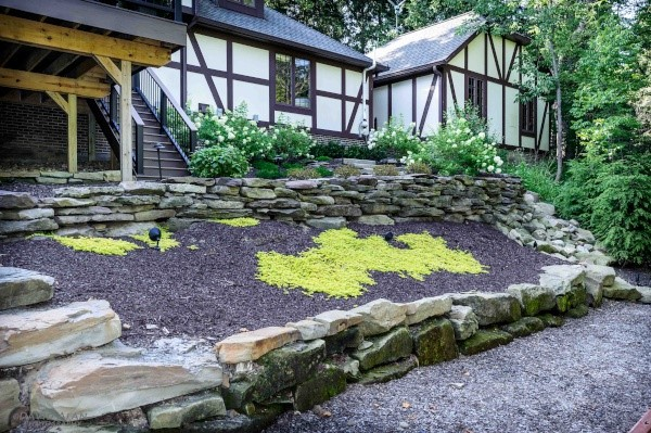 Natural Stone Work Landscape Projects & Retaining Walls in the Cleveland Area Designed & Built by H&M Landscaping.