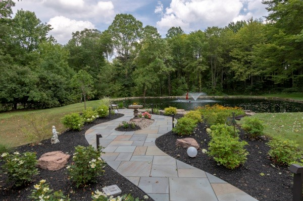 Stone Walks & Patios, Using Stone Products & Pavers, Designed & Installed by Cleveland Area Landscapers at H&M Landscaping.
