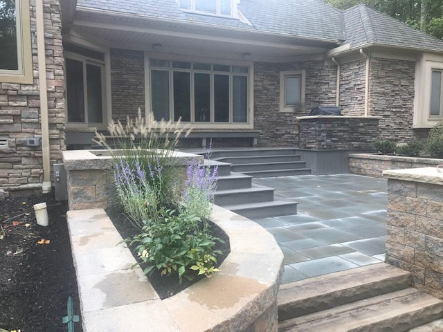 Landscape Outdoor Patio Design by H&M Landscaping